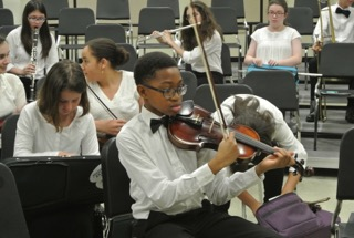 Violinist at a Rehearsal