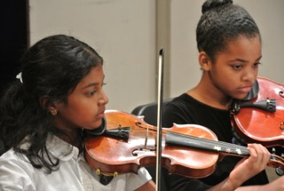 Violinists at a Performance